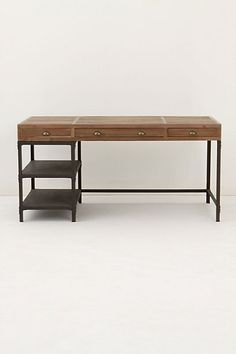 natural wood desk that is begging for a bright chair to accompany it...