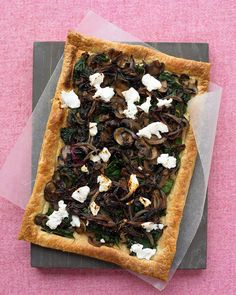 Purchased puff pastry makes easy work of this savory vegetarian tart topped with mushrooms, spinach, caramelized onions, and flecks of goat cheese. You may use any variety of mushrooms you like, including cremini, shiitake, portobello, or a mixture of wild mushrooms.