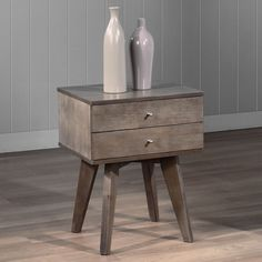 Add a contemporary touch to your living space with this Draper two-drawer nightstand. A lovely charcoal grey finish highlights this wooden nightstand.