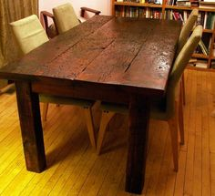 """Beautiful reclaimed barn wood harvest table. These boards were used as road into the barn. They have a lot of marks from machinery, nail holes, knots, knot holes and a hoof print or two.     The top is 2"""" thick and the legs are 4"""" x 4""""."""