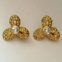Vintage gold tone ear clips with crystals in shape of flower