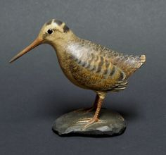 "Woodcock Frank Finney, Cape Charles, VA.  Measures 4"" tall x 4 5/8"" long, base is 2"" wide x 2 ½"" long. Signed with a scrolled ""F"" on top of base."