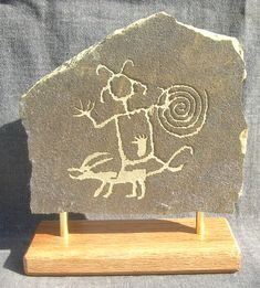 Anasazi petroglyph, New Mexico. [Possibly depicts a shaman's performance, or a warrior with a shield & his dog.. JE]