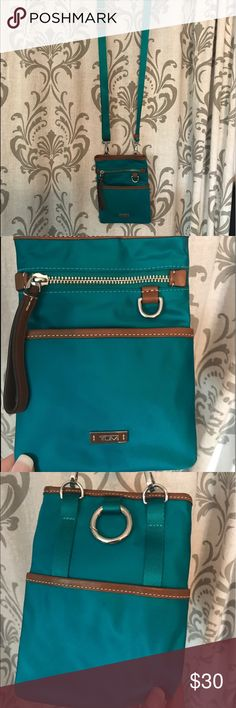 Authentic teal tumi travel crossbody Never been used !! Tumi Bags Travel Bags