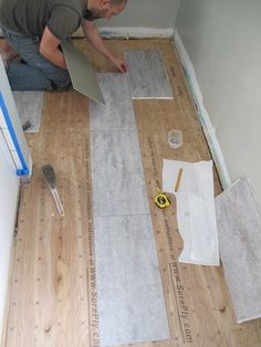 looking for kitchen flooring ideas. found groutable vinyl tile at
