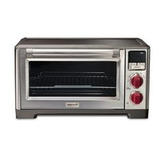 Check out this countertop convection oven from Wolf Gourmet. #wolf performance and love the red knobs!