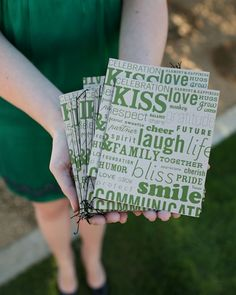 Quirky kraft paper-covered program booklets are adorned with lighthearted words associated with a happy marriage.