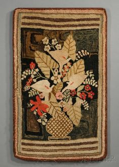 Pictorial Hooked Rug Depicting a Vase of Flowers, America, late 19th century, rectangular rug composed of wool and cotton fabric segments and wool yarn hooked onto a burlap foundation, with striped