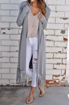 """Luxurious, long sleeve duster cardigan featuring a fringed hem and an effortless maxi silhouette. 55% Nylon 