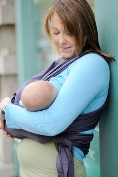 Instructions and tips for breastfeeding in a Moby Baby Carrier. Nurse your baby while carrying your baby in the comfortable Moby Wrap. Plus breastfeeding success tips from Best for Babes.