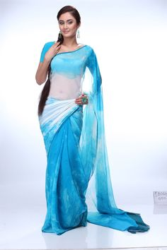 A charming georgette saree for any time occasion. The pallu with white and sky blue blend makes it look very subtle. The thin border in dark blue contributes to the prettiness of it.Shop onliine at www.satyapaul.com and visit us at www.facebook.com/SatyaPaulIndia