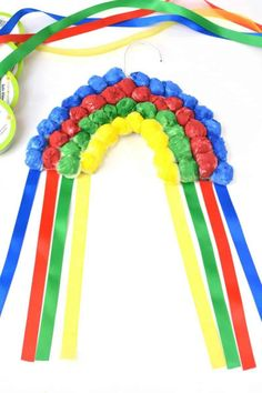 If you are looking for a rainbow kids craft for St. Patrick's Day or just for Spring in general, this colorful Hanging Cotton Ball Rainbow Craft for Kids is the perfect idea.