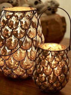 Blogger Melissa from The Happier Homemaker made a hurricane lantern out of plastic spoons and metallic paint, for a homemade version of a Pottery Barn favorite.
