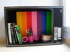 Old TV set repurposed as a bookshelf.