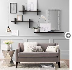 Maybe something like this for the blank wall behind the sofa?