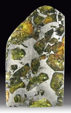 Pallasite - a variety of Meteorite that has olivine crystals embedded inside a nickel iron matrix. From Esquel, Argentina