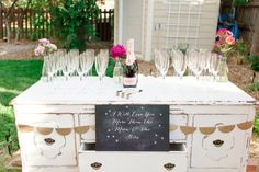 Champagne station on a vintage dresser   Connie Dai Photography   http://burnettsboards.com/2014/01/style-backyard-engagement-party/