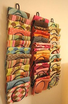 These 15 tips on ways to organize scarves will help you keep them neat and tidy whether theyre in your drawer your closet or on display in your room. Craft Room Organisation, Scarf Organization, Organizing Ideas, How To Store Scarves, Sewing Room Storage, Fabric Storage, Fabric Organizer, Paper Storage, Organize Fabric