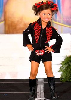 Shining Stars of Toddlers & Tiaras Photo Gallery: Toddlers & Tiaras: TLC    wtf why would a lil girl look like this... omg!!!!!!!!!!!!!!!!!!!!!!