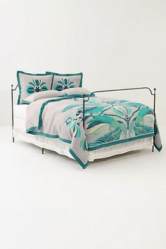 loving the colors in the green cockatoo duvet cover