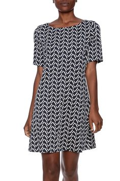 Navy printed dress with a boat neckline, short sleeves and a back zipper closure.Machine washable.   Short Sleeve Dress by Julie Brown NYC. Clothing - Dresses - Casual Clothing - Dresses - Printed Clothing - Dresses - Short Sleeve Pennsylvania