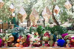 A fun tropical theme with palms and pinatas!