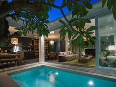 oh. my. goodness. perfect. Dark, open living spaces looking over enclosed functional water.