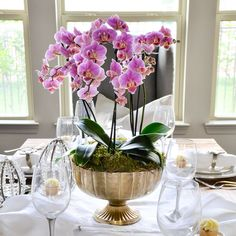 I have recently found myself using orchids in my home more frequently. They are simple yet stunningly elegant and they tend to last longer than freshly cut flowers. So naturally, when I began to design my Easter table, orchids came to mind. While I wanted to do something different than last year (see my 2016 … Easter Table Decorations, House Decorations, Easter Decor, Orchid Plants, Flower Centerpieces, Easter Centerpiece, Orchid Arrangements, Succulent Arrangements, Floral Arrangement