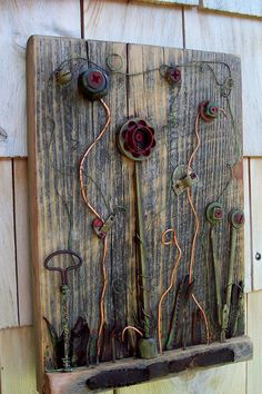 Found object Art Assemblage, vintage garden on reclaimed Barn wood. $120.00, via Etsy.