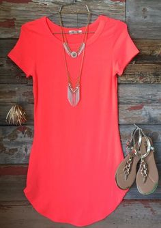 The Fun in the SunTunicDress in Neon Coral is comfy, fitted, and oh so fabulous! A great basic that can be dressed up or down!  Sizing: Small: 0-3 Medium: 5-