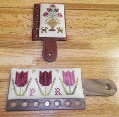 These are hornbooks to hold your threads when you are stitching. Love it on its side!
