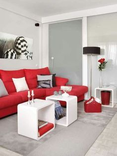 Red couch with white pillow