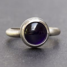 Sterling silver ring with amethyst cabochon - handmade by Rebecca Cordingley