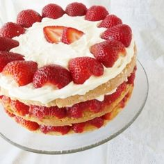 French Strawberry Cake.  A three layered genoise cake is filled with macerated berries and lightly sweetened whipped cream.  The perfect summer dessert.