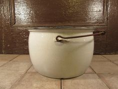 Nice large white speckled enamelware pot with metal and wood swing handle- fine…