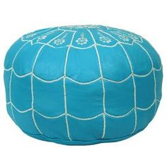 "Showcasing a Moroccan-inspired arch motif and turquoise hue, this handmade leather pouf is perfect as an extra seat or exotic footrest.  Product: PoufConstruction Material: Genuine leather and shredded foam fillColor: TurquoiseFeatures:    Handmade in MoroccoCan be used as an ottoman or extra seating  Dimensions: 12"" H x 21"" Diameter"