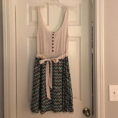 Dress Gorgeous free people dress! Size medium. Loved this dress for many years but now it's time to part. Danty lace top with blue, green, brown, and gold flows bottom. Free People Dresses Midi