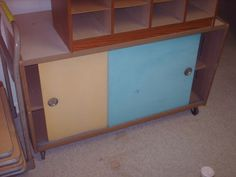 A  vintage-style cabinet with sliding doors. A new (high gloss) paint job and this could be super freaking awesome.