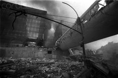 WTC 7 out of view on right. WTC 5 (left) and WTC 6 (right) visible across Vesey. World Trade Center Buildings, 11 September 2001, Front Page News, Pearl Harbor, Solomon, Zero