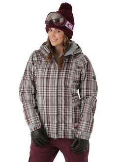 Danniellen in grey tartan pattern with burnt red & black trim on her ski jacket.