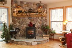 Rustic Log Mantel & Stone Fireplace - rustic - family room - other metro - by Woodland Creek Furniture