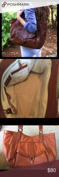 Brown leather Cole Haan purse Beautiful leather Cole Haan handbag. Classic bag perfect for work or school. Clean inside well taken care of. Outside pocket as well as a zipper pocket and 2 pockets inside as shown in picture Cole Haan Bags Shoulder Bags