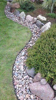 rock garden The crisp line between the lawn and rock boarder is achieved by using bendable steel garden edging. An additional layer of larger boulder rocks gives more interest and quot;holds the plants backquot; in the planted area. Outdoor Landscaping, Front Yard Landscaping, Outdoor Gardens, Rocks In Landscaping, Landscape Rocks, Dry Riverbed Landscaping, Landscape Timbers, Decorative Rock Landscaping, Decorative Garden Stones