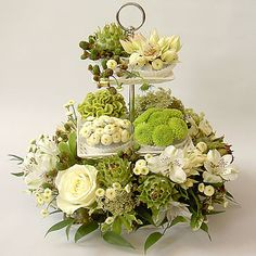 Centerpiece: Floral cake stand w/blackberries and artichokes
