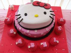Hello Kitty birthday party cake and cupcakes! See more party ideas at CatchMyParty.com!