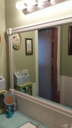 Those big contractor mirrors in bathrooms!  they are huge!!  But I like them, but so plain.  I added wood trim from Lowe's, we glued it on with silicon glue that dries clear!  Love it now! And by using the corner pieces, we didn't have to miter the corners!