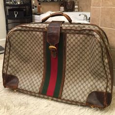 Vintage GUCCI Huge Travel Suitcase Bag I purchased this at a cool store on Santa Monica Blvd.. With thoughts of making it into a cool coffee table! It is a reflection of Old World Money..  It is very tattered and worn but I feel it adds to its sass!  Please see the second listing for full coverage of the wear!  Gucci Bags Travel Bags