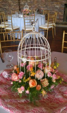 bird cage with flowers.