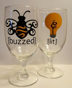 Buzzed and Lit Wine Glasses....set of 2...wine glass set with vinyl bee and bulb designs by KimmsHomeDecor on Etsy