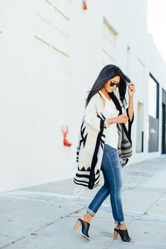 knitted cape with distressed jeans